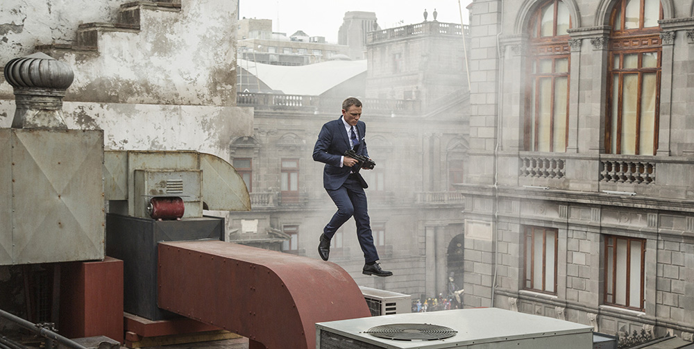 Bond (Daniel Craig) runs along the rooftops in pursuit of Sciarra in Mexico City in Metro-Goldwyn-Mayer Pictures/Columbia Pictures/EON Productions™ action adventure SPECTRE.